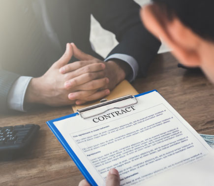 Employee Signing a contract with Attorney